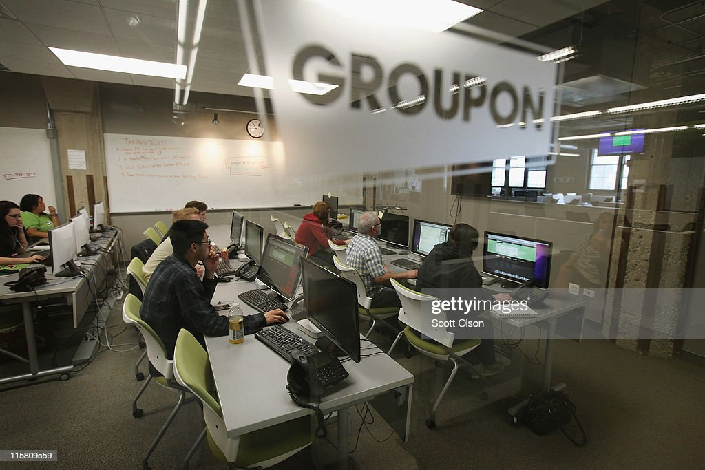The Groupon logo is engraved in a glass office partition in the company's international headquarters on June 10 2011 in Chicago Illinois Groupon a...