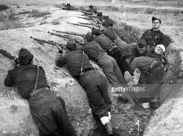 The Guadarrama trenches of the Nationalists in the battles of Madrid The soldiers with their guns are in positon whilst a wounded is carried away...