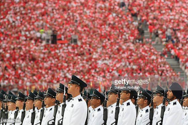 The guard of honour contingent is seen during the National Day Parade at Padang on August 9 2015 in Singapore Singapore is celebrating her 50th year...