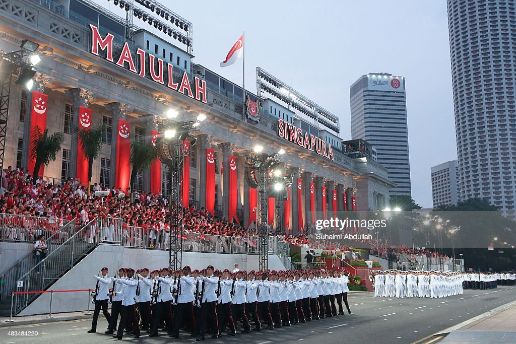 The guard of honour contingent march past in front of the City Hall during the National Day Parade at Padang on August 9, 2015 in Singapore. Singapore is celebrating her 50th year of independence on August 9, 2015.