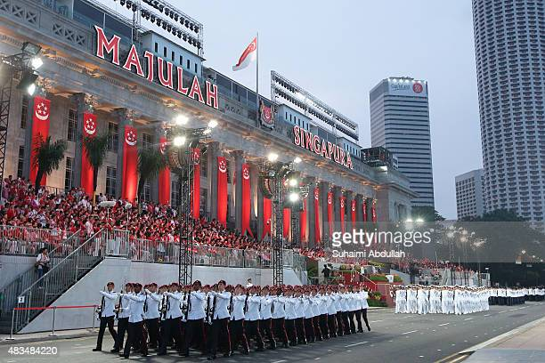 The guard of honour contingent march past in front of the City Hall during the National Day Parade at Padang on August 9 2015 in Singapore Singapore...