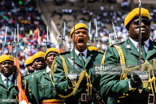 TOPSHOT The guard of honour parade during the country's 37th Independence Day celebrations at the National Sports Stadium in Harare April 18 2017 /...