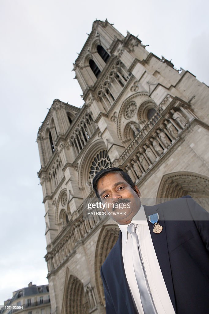 The guardian of the Notre-Dame de Paris cathedral Joachim Irudayanathan, born to a French mother and an Indian father, poses for a photograph outside the cathedral, on November 29, 2012, in Paris.