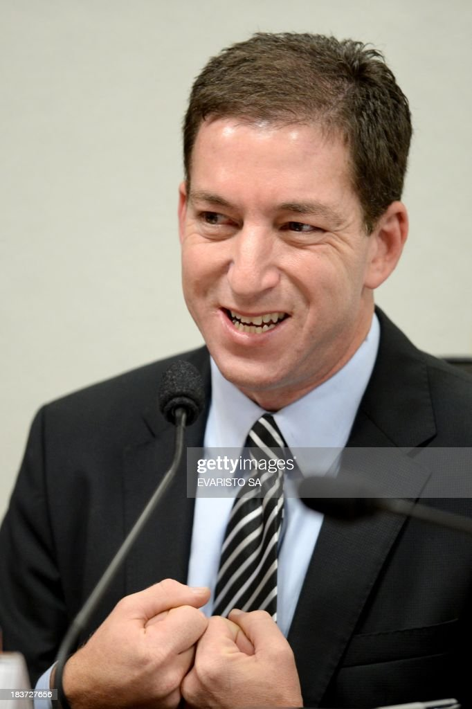 The Guardian's Brazil-based reporter Glenn Greenwald, who was among the first to reveal Washington's vast electronic surveillance program testifies before the investigative committee of the Senate that examines charges of espionage by the United States in Brasilia on October 9, 2013, following press reports of US electronic surveillance in Brazil based on leaks from Edward Snowden, a former US National Security Agency contractor. AFP PHOTO/Evaristo Sa