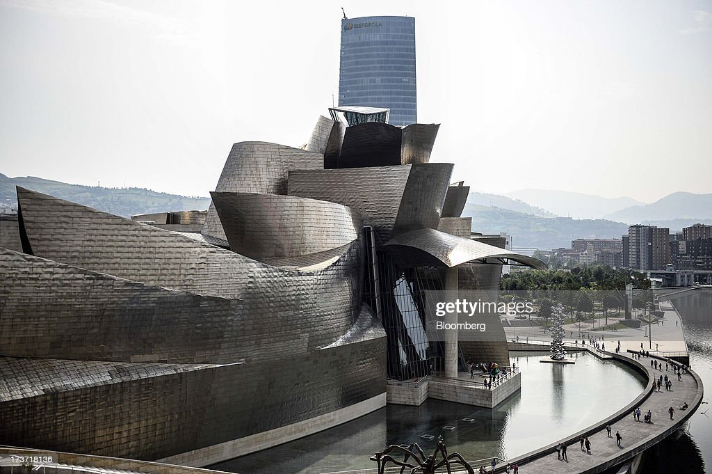 The Guggenheim Museum designed by Frank Gehry stands in Bilbao, Spain, on Tuesday, July 16, 2013. Spain has covered 63.2 percent of its issuance target for 2013 including short-term bills after a debt sale yesterday and is open to other forms of funding, an Economy Ministry official said. Photographer: David Ramos/Bloomberg via Getty Images