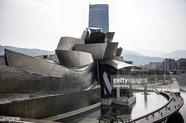 The Guggenheim Museum designed by Frank Gehry stands in Bilbao Spain on Tuesday July 16 2013 Spain has covered 632 percent of its issuance target for...