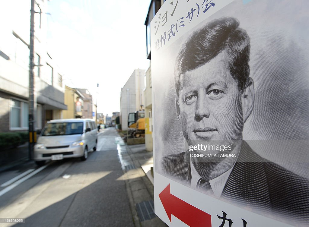 The guide poster for the mass in honour of former US president John F. Kennedy on the 50th anniversary of his assassination, is displayed near the San-no Cho Catholic Toyama church in Toyama on November 23, 2013. About 100 followers in different religions gathered to mourn the late US president.