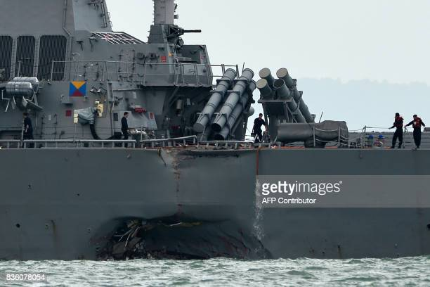 The guidedmissile destroyer USS John S McCain is seen with a hole on its portside after a collision with an oil tanker outside Changi naval base in...