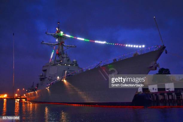 The guidedmissile destroyer USS Michael Murphy shows off holiday lights during the 2012 Holiday Ship/Submarine Lighting Contest December 17 2012...