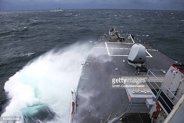 The guidedmissile destroyer USS Porter DDG 78 conducts advanced maneuvers with the Romanian navy ship ROS Regina Maria F 222 in the Black Sea Image...