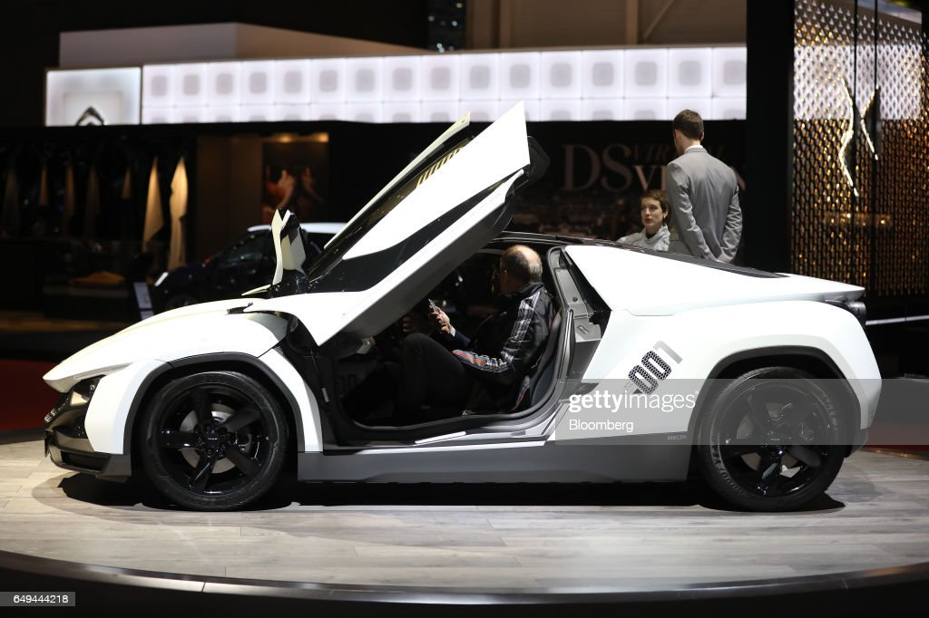 The gullwing doors of a Tata Motors Ltd TAMO Racemo luxury automobile sit open as it & Gull Wing Doors Stock Photos and Pictures | Getty Images Pezcame.Com