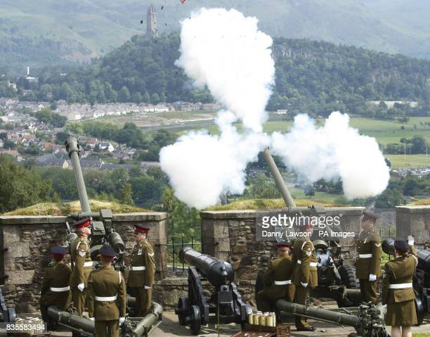 The gun battery fires during the Royal Gun salute to mark the Queen's birthday at Stirling Castle in Scotland