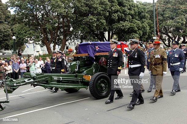 The gun carriage bearing the casket of the unknown warrior passes Parliament on the way to interment at the National War Memorial Wellington New...