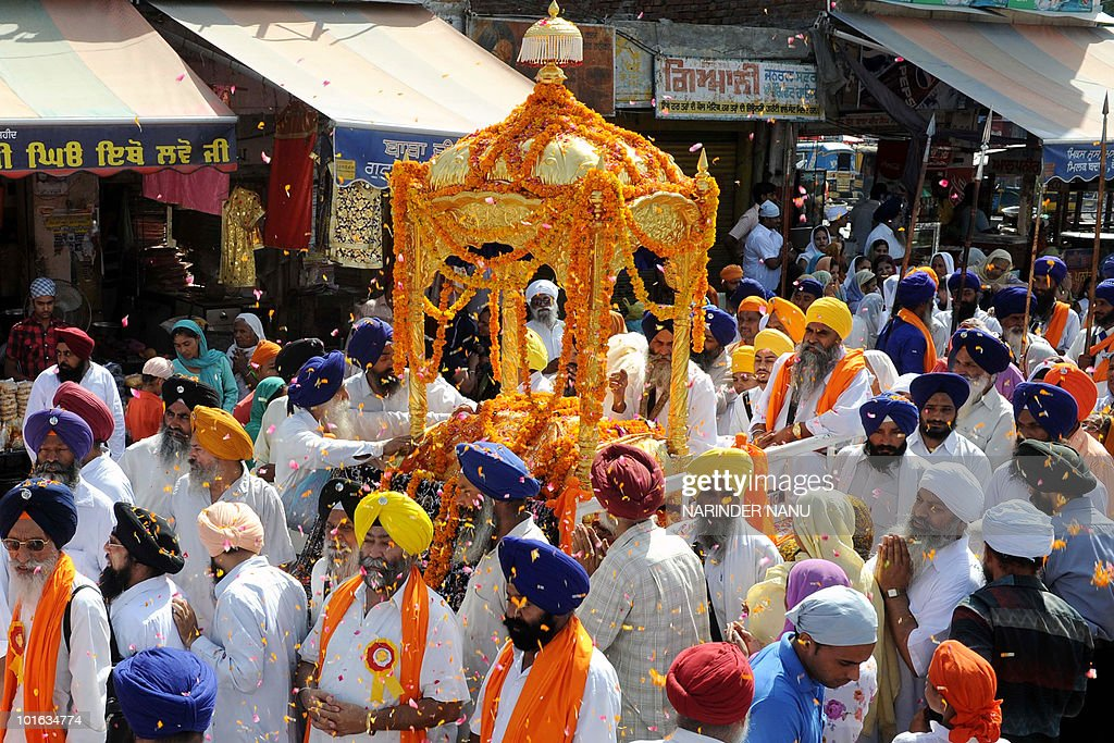 The Guru Granth Sahib (Sikh Holy Book) (C) is carried during a procession celebrating 'Fateh Divas' celebrations in Amritsar on June 5, 2010. This year marks the 300 years of the Fateh (victory) of Sirhind and the establishment of the first Khalsa Raaj.