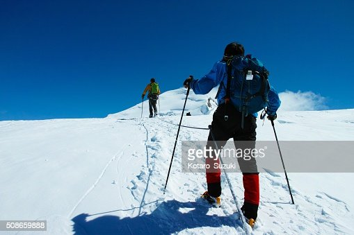 The guys challenging on top of the Snow Mountain. : Stock Photo