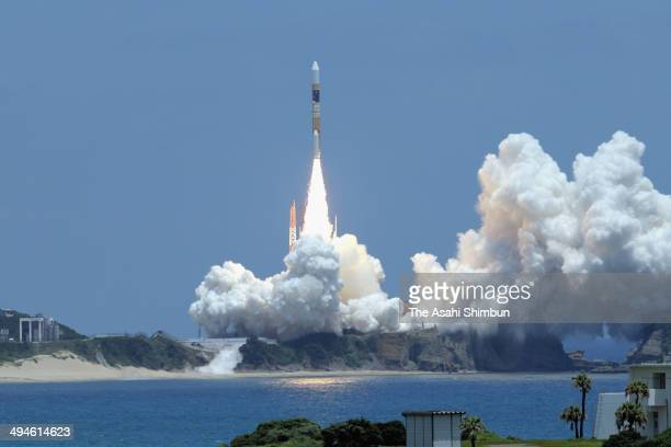 The H2A Launch Vehicle No 24 lifts off from the Tanegashima Space Center on May 24 2014 in Minamitane Kagoshima Japan The Japan Aerospace Exploration...