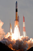 The H2A Launch Vehicle No29 of the Japan Aerospace Exploration Agency and Mitsubishi Heavy Industries lifts off from the launch pad at the JAXA...