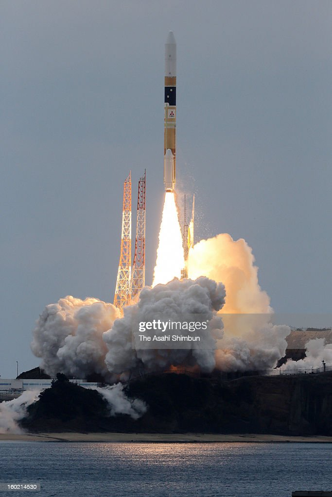 The H2A-22 rocket, developed by The Japan Aerospace Exploration Agency (JAXA) and Mitsubishi Heavy Industries Ltd. lifts off from the launch pad at JAXA's Tanegashima Space Center on January 27, 2013 in Minamitane, Japan. The rocket carries information-gathering radar satellite and optical satellite.