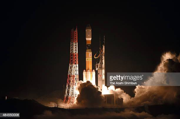 The H2B rocket lifts off from the Japan Aerospace Exploration Agency 's Tanegashima Space Center on August 19 2015 in Minamitane Kagoshima Japan The...