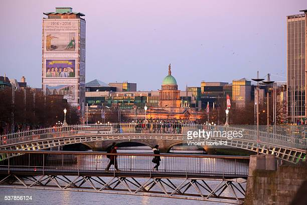 The Ha penny Bridge as foreground and the Custom House dome as background pictured on April 20 2016 in Dublin Ireland Illustrative picture of the...