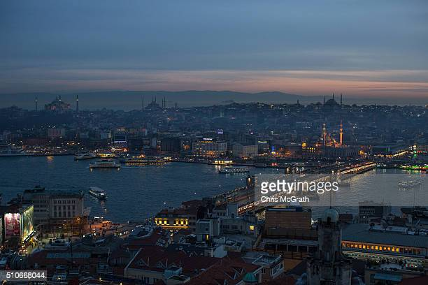 The Hagia Sophia the Blue Mosque and the Yeni Mosque are seen at sunset on February 16 2016 in Istanbul Turkey Istanbul is famous for its skyline...