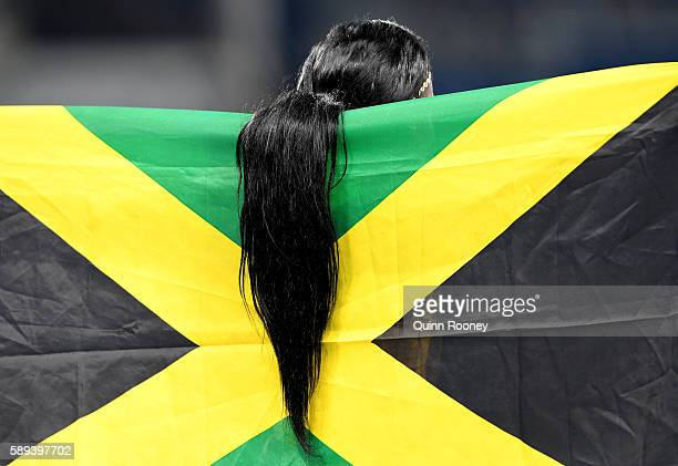 The hair of Elaine Thompson of Jamaica as she celebrates after winning the Women's 100m Final on Day 8 of the Rio 2016 Olympic Games at the Olympic...