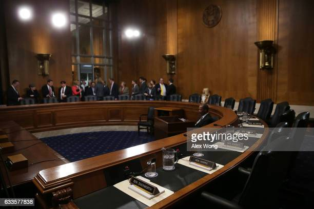 The half dais on the Democratic side is seen empty as Republican members and their staff wait on their side for the beginning of a meeting of Senate...