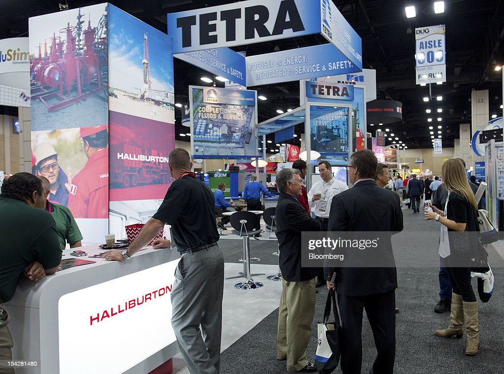 The Halliburton Co., left, and Tetra Technologies Inc. exhibit booths stand at the DUG Eagle Ford Conference & Exhibition in San Antonio, Texas, U.S., on Monday, Oct. 15, 2012. Marathon Oil Corp., the U.S. oil and natural gas producer that spun off its refining business last year, is seeking to sell more than 96,000 net acres in the Eagle Ford formation in Texas. Photographer: Eddie Seal/Bloomberg via Getty Images