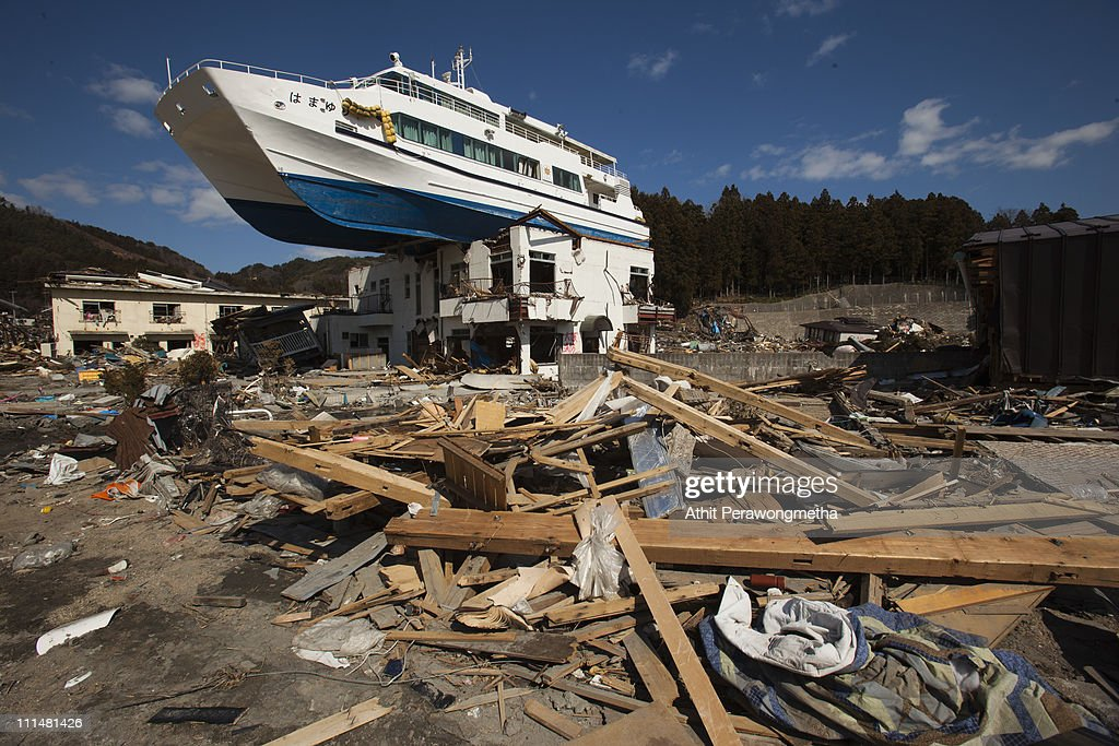 The Hamayuri a catamaran signtseeing boat sits atop a twostory Japanese inn building in the tsunami debris on on April 3 2011 in Iwate Prefecture...