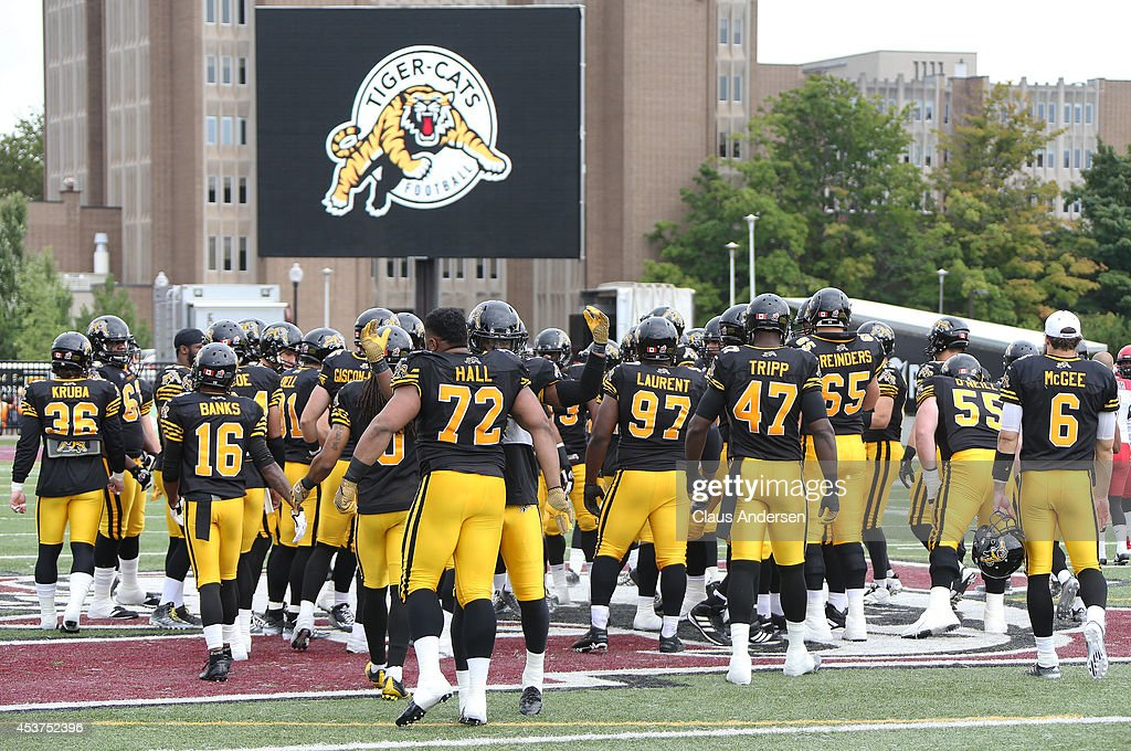 The Hamilton TigerCats get set to play against the Calgary Stampeders in a CFL game at Ron Joyce Stadium on August 16 2014 in Hamilton Ontario Canada...