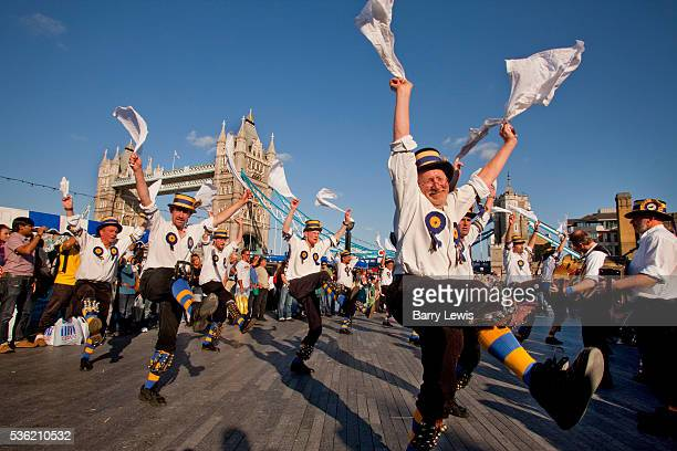 The Hammersmith Morris Men performing in front of Tower Bridge during the Thames Festival 2009