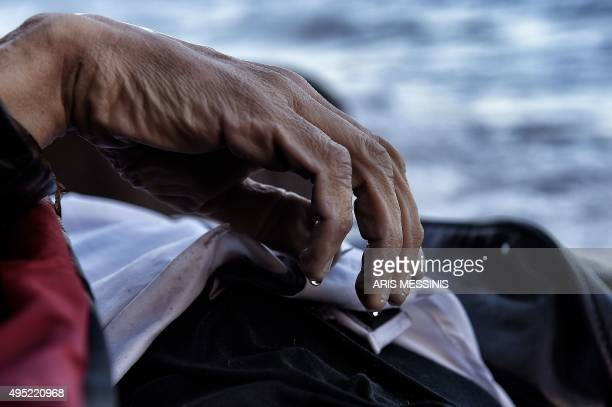 The hand of a dead man is pictured on a beach of the Greek island of Lesbos on November 1 after boats transporting migrants and refugees trying to...