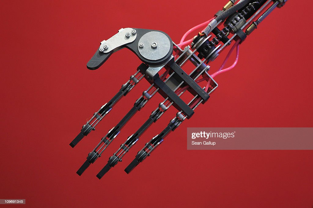 The hand of a Robothespian communications and entertainment robot mimics the gestures of a person standing nearby at the CeBIT technology trade fair on March 1, 2011 in Hanover, Germany. CeBIT 2011 will be open to the public from March 1-5.