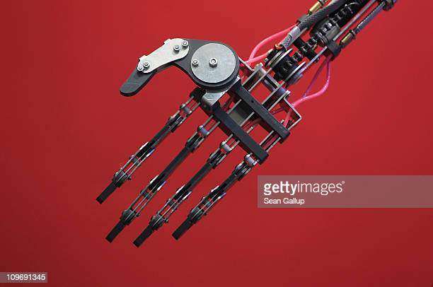 The hand of a Robothespian communications and entertainment robot mimics the gestures of a person standing nearby at the CeBIT technology trade fair...