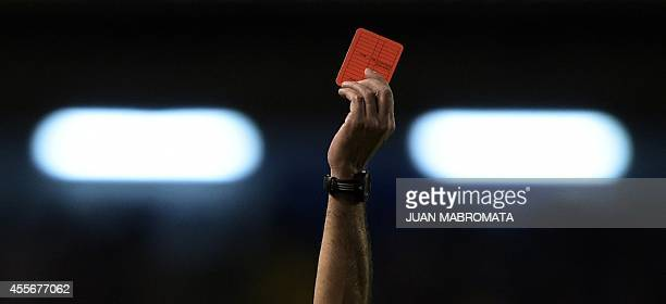 The hand of Argentine referee Diego Abal showing the red card to Rosario Central's defender Lucas Acevedo during their Copa Sudamericana 2014 second...