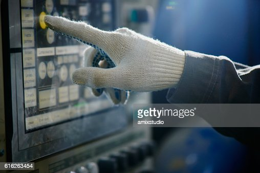 The hand of the worker clicks on the control screen : Stock Photo