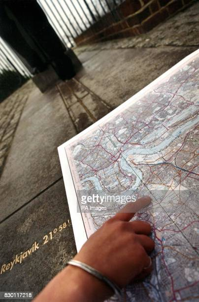 Maria blyzinsky the Curator of Astronomy at the Royal Observatory in Greenwich indicates the route of the Greenwich Meridian as it will appear on a...