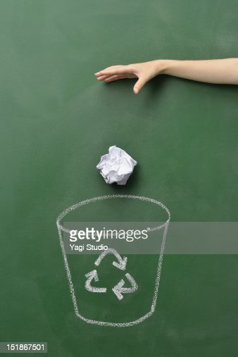 The hand which abandons a trash box and paper