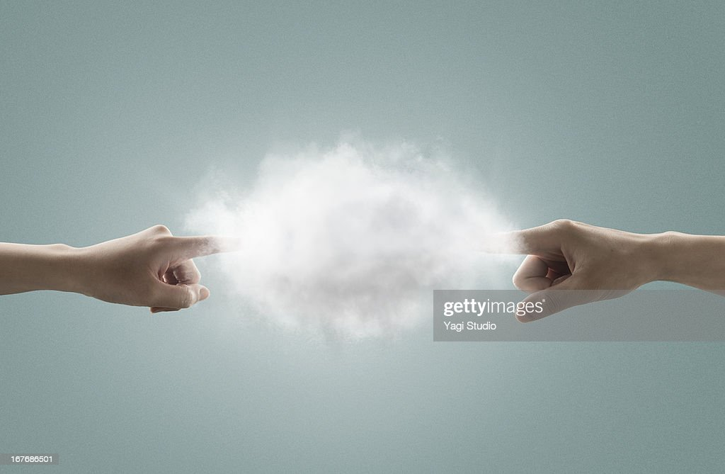The hand which touches a cloud : Stock Photo