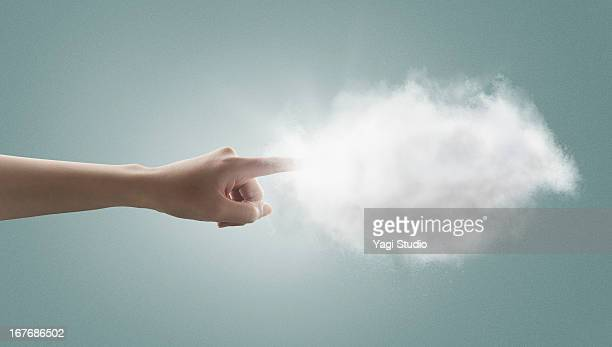 The hand which touches a cloud