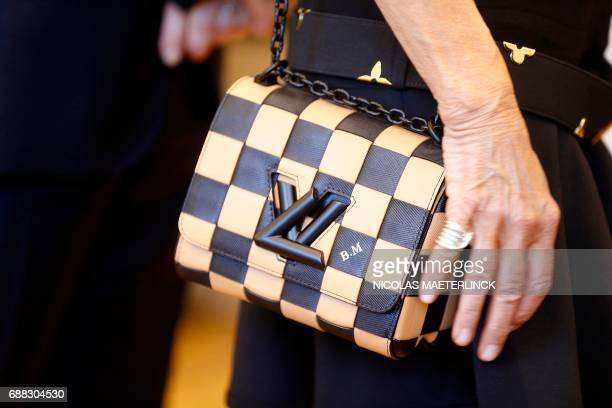 The handbag of Brigitte Macron wife of French President with the initials 'BM' is pictured during a visit of the First Ladies to a shop of Belgian...