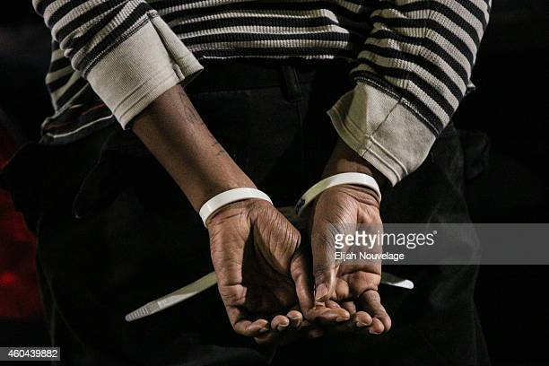 The hands of a black protester are seen following his arrest at a 'Millions March' demonstration protesting the killing of unarmed black men by...