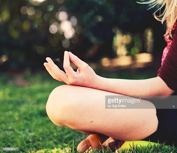 The hands of a young  yogini
