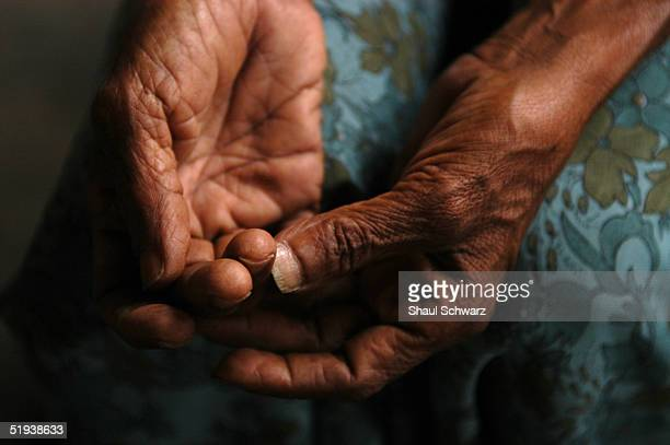 The hands of an old woman at a refugee camp for tsunami survivors January 8 2005 in Matara Sri Lanka Two of the schools in town have turned been...