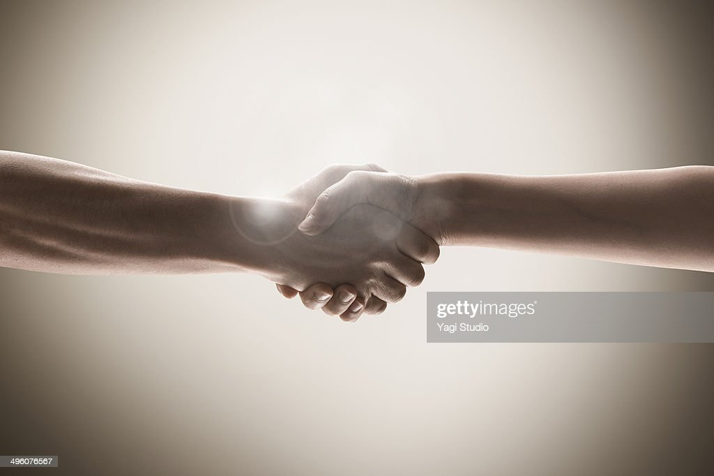 The hands of men and women holding hands
