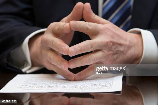 The hands of President Donald Trump while attending a meeting on healthcare in the Roosevelt Room of the White House on March 13 2017 in Washington...