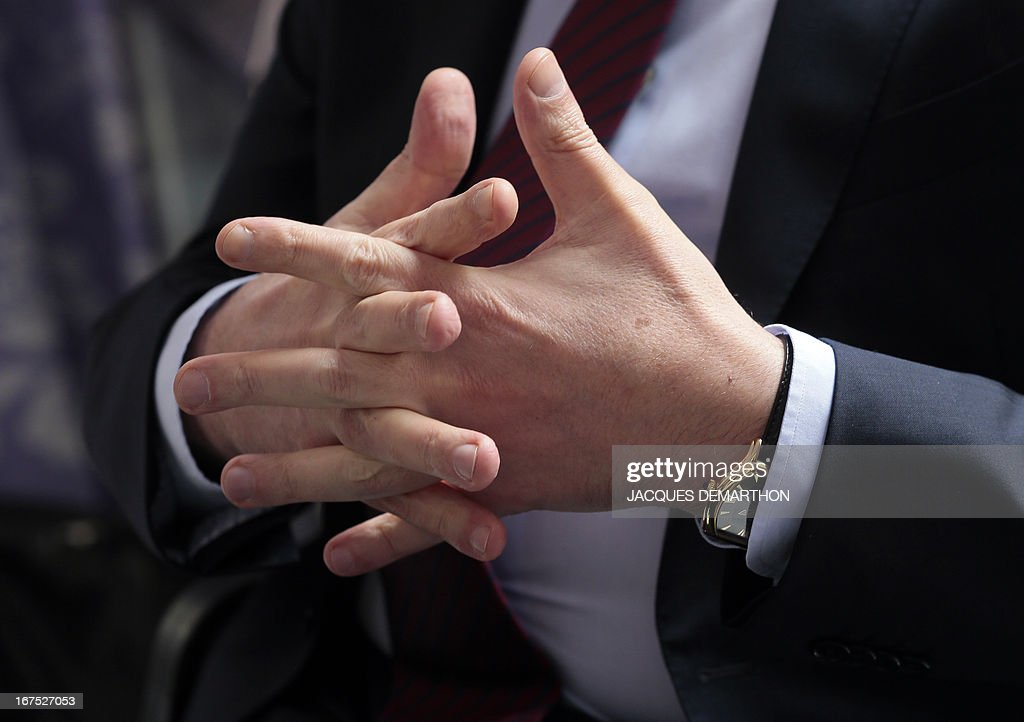 The hands of the president of the Nagorny Karabakh region's unrecognised government, Bako Sahakian are pictured during an interview on April 26, 2013 during his three-day visit to Paris. The international community must take Azerbaijan's threats of regaining the disputed region of Nagorny Karabakh seriously and condemn Baku's ongoing arms-buying spree, the breakaway territory's leader said Friday.