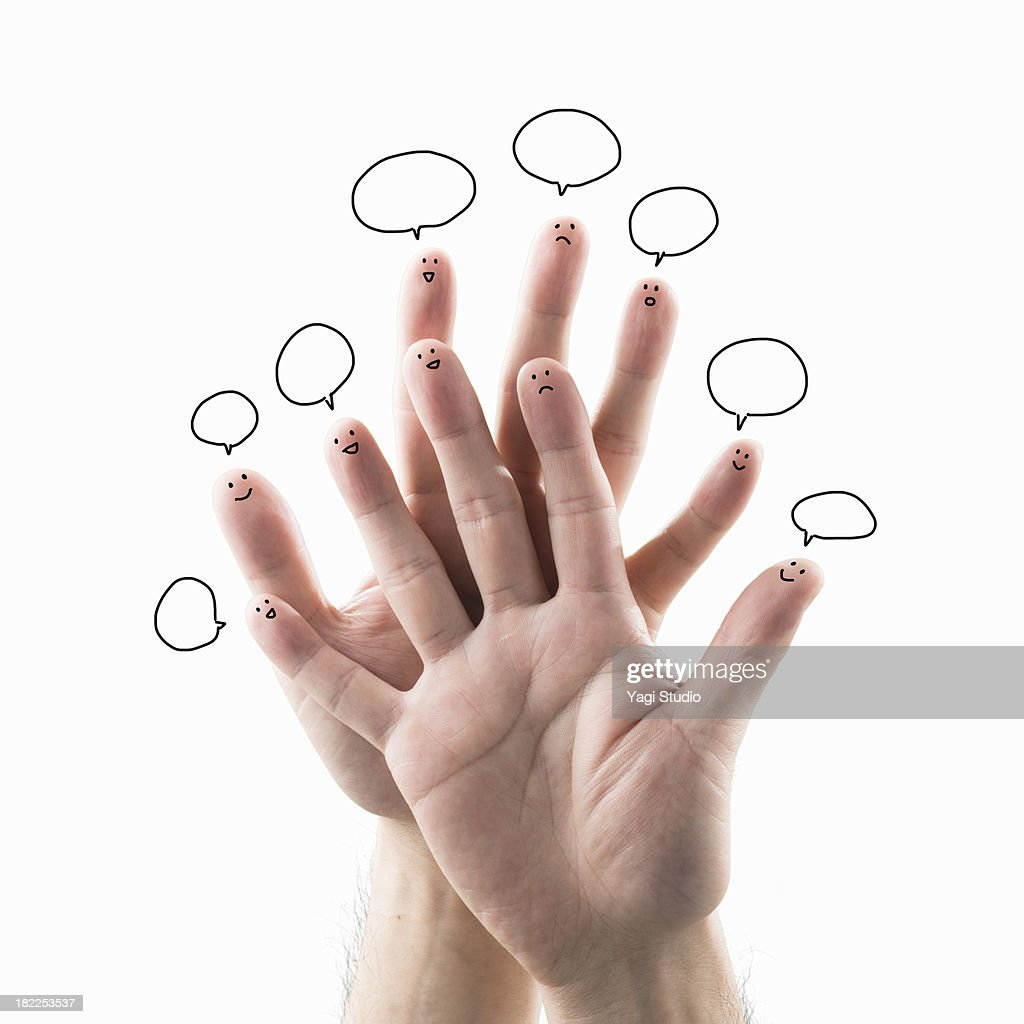 The hands which a face is drawn on on a finger-tip : Stock Photo