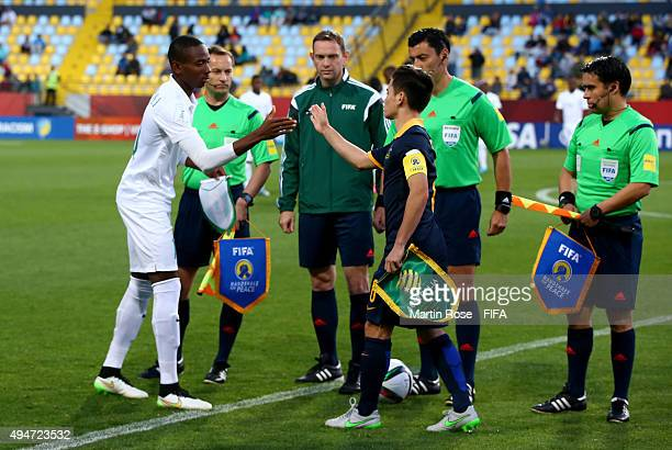 The handshake of peace between Kelechi Nwakali of Nigeria and Joe Caletti of Australia before the FIFA U17 Men's World Cup 2015 round of 16 match...