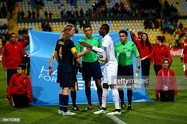 The handshake of peace between Kelechi Nwakali of Nigeria and Kye Rowles of Australia before the FIFA U17 Men's World Cup 2015 round of 16 match...